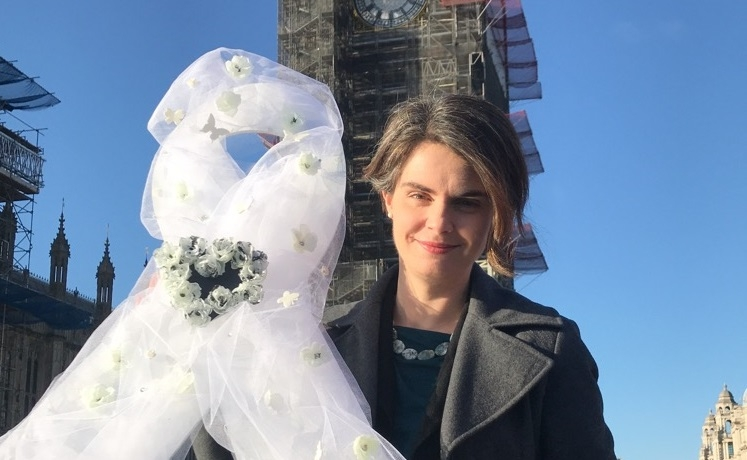 Chloe Smith holds a white ribbon