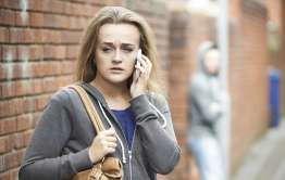 girl makes phone call as act of stalking protection