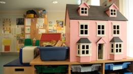 pink wendy house in a safe house playroom